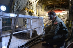 Petty Officer 2nd Class Garth Booye, an aviation maintenance technician at Coast Guard Air Station Barbers Point, ensures a carrier transporting two rehabilitated Hawaiian monk seals is properly secured in an HC-130 Hercules airplane. Coast Guard crews working with the National Oceanic and Atmospheric Administration transported the seals from the Big Island to Oahu for future release back to the Northwestern Hawaiian Islands. U.S. Coast Guard photo by Petty Officer 2nd Class Tara Molle.