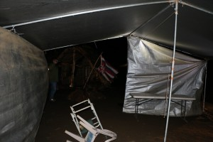 Department of Land and Natural Resources officials take down a tent that was set up across from the Mauna Kea Visitor Center. DLNR photo.