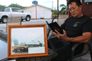 Colin Nakagawa, president of The Seaside Restaurant & Aqua Farm, is seen here looking at one of his menus.