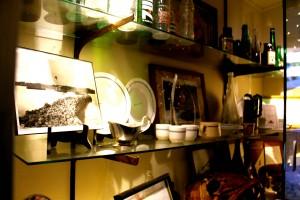 The following image depicts a wall of memorabilia at the Seaside Restaurant & Aqua Farm.