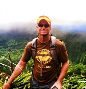 Curt Cottrell hiking. DLNR photo.