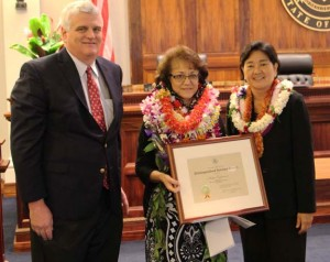 Chief Justice Mark Recktenwald (left) and Associate Judge Lisa Ginoza (right) congratulate Hattie Embernate, Fiscal Office, Office of the Court Administrator, Third Circuit (center), recipient of the Judiciary's 2015 Distinguished Service Award. Hawai'i State Judiciary photo.