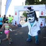 A young finisher is greeted at the finish line of the 2015 Ironkids Keiki Dip-n-Dash at Kailua Pier. Photo credit: UnitedHealthcare.