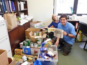 Makana Watson and Judy Donovan inventory donated food items. Kona Community Hospital courtesy photo.