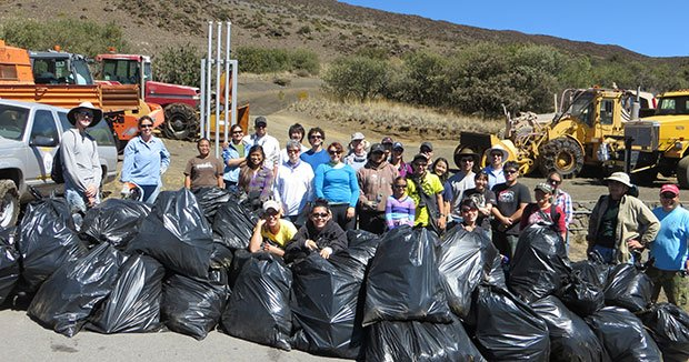 Volunteers removing invasive weeds at Halepōhaku. Photo courtesy Office of Maunakea Management.