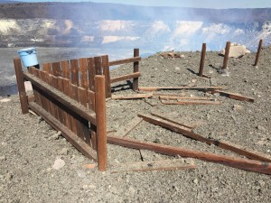 The January 8, 2016, rockfall and subsequent explosive event littered the rim of Halemaʻumaʻu Crater with fragments of molten lava. In this image, you can see what remains of the Halemaʻumaʻu Overlook wooden fence, which has been repeatedly been bombarded by spatter and rock fragments since 2008. HVO photo.