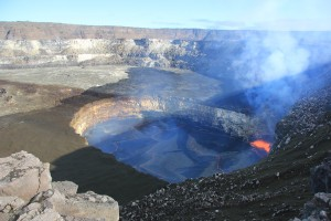 In this photo of Kīlauea Volcano's summit lava lake, the light-colored rock in the vent wall to the left of the spattering lava shows were the rockfall occurred on January 2. HVO image.