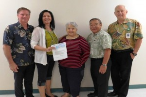 Kona Community Hospital and Kona Hospital Foundation leaders accept the grant from Reginald Morimoto with First Hawaiian Bank. in this photo. KCH courtesy photo.