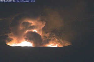 In this image, captured by a USGS Hawaiian Volcano Observatory webcam, the dusty gas plume can be seen rising from the vent after rocks impacted the lava lake. Incandescence from molten lava exposed by the disrupted lava lake surface lit up the vent wall and the night sky above Halemaʻumaʻu Crater. HVO image.