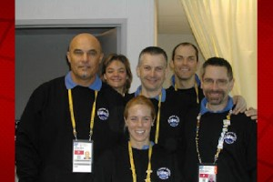 Dr. Geno Ortiz (left), along with members of the World's Massage Team. Go-Team Massage Clinic website photo.