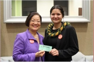 Senator Hirono and Sierra Schmitz holding Sierra's State of the Union ticket. Photo courtesy of the Office of Senator Mazie Hirono.