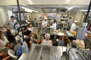 Culinary Arts instructor Paul Heerlein presents a cooking demonstration with one of his students. The new campus features two new teaching kitchens with brand new equipment. Hawai'i Community College – Pālamanui photo.