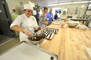 Culinary Arts student makes chocolate truffles for visitors at the Open House and Grand Opening Celebration. The new campus features two new teaching kitchens with brand new equipment. Hawai'i Community College – Pālamanui photo.