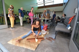 Hawaiian Studies student makes kapa. Hawai'i Community College – Pālamanui photo.
