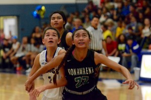 Konawaena's Celena Molina (22) boxes out for a rebound against Hilo's Sharry Pagan (2) during last Friday's game. Photo courtesy: Jared Fujisaki.