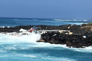 This catamaran, called the Sea Paradise, crashed in this location of Honokohau Harbor on Thursday evening. Photo credit: Marcy Anderson.