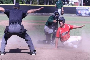 UH-Hilo first baseman Phillip Steering slides in safely at home ahead of a tag by Hawai'i catcher Chayce Ka'aua. UH-Hilo photo.