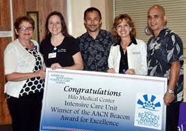 Hospital and Foundation leadership congratulate the ICE nursing staff for winning the Beacon Award for Excellence, a national recognition for intensive care until across the country. Hilo Medical Center courtesy photo.