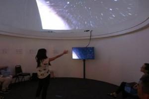 Subaru Outreach Director Dr. Yuko Kakazu navigating the WorldWide Telescope. 'Imiloa Astronomy Center image.