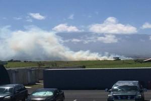 A view of a brush fire in Waimea on Monday. Photo credit: Keoni Delacruz Veloria