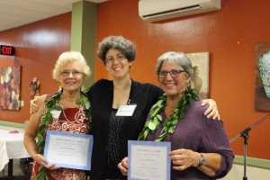 Kathy Hammes (left) and Evelyn Pacheco (right) received Volunteer of the Year certificates from Ku'ikahi Mediation Center Executive Director Julie Mitchell . Ku'ikahi Mediation Center.