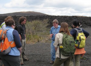 Don Swanson talks about Kīlauea Volcano's 1969–1974 Mauna Ulu eruption with geology students from Franklin and Marshall College during their 2015 field trip to Hawai'i Volcanoes National Park. Photo courtesy of Stan Mertzman, Franklin and Marshall College.