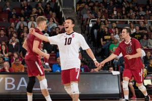 Stanford sophomore Evan Enriques (center) celebrates during a game against Long Beach State this season. Photo credit: Mike Rasay/StanfordPhoto.com