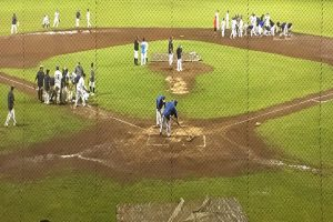 Players from Waiakea and Hilo work together to dry the field at Wong Stadium during a 46-minute rain delay. Photo by Josh Pacheco.