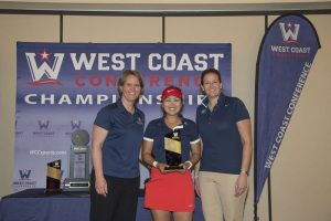 WCC commissioner Lynn Holzman (left), Gonzaga Bulldogs golfer Ciera Min (center), and BYU Cougars associate athletic director Elizabeth Dargar (right) pose for a photo after Min received the individual champion trophy during the WCC Golf Championships at Blackhawk Country Club. Photo courtesy: Kyle Terada/WCC