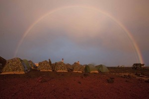 A rainbow arches over falling over the Pohakuloa Training Area during a during Rim of the Pacific (RIMPAC) 2010 training exercise. U.S. Marine Corps photo by Lance Cpl. Reece E. Lodder.