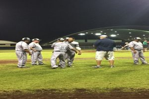 Kamehameha-Hawai'i freshman Tai Atkins is greeted by his coaches after Friday's start. Photo credit: Cheri Atkins.