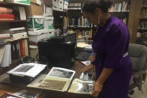 "In Kona Historical Society's archives, Mina Elison, curator and future Kona Museum Gallery director, works on the two ""Kona Ranching and Kona Cowboys"" exhibits that will be presented this summer. Photo By Carolyn Lucas-Zenk 