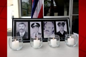 """Candles burn during a Police Week ceremony last year in honor of Officers Manuel Cadinha, William """"Red"""" Oili, Ronald """"Shige"""" Jitchaku and Kenneth Keliipio. HPD file photo."""
