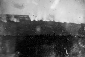 This daguerreotype image, captured in 1855 by Hugo Stangenwald, is the earliest known photograph of Kīlauea Volcano. Although scratched and faded, the 161-year-old photo shows a line of steaming vents across the floor of Kīlauea's summit caldera as viewed from a location near today's Volcano House Hotel. The caldera rim is visible in the lower third of the image. Photo courtesy of Hawaiian Mission Houses Historic Site and Archives.