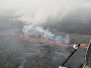 On May 25, the northern breakout on Puʻu ʻŌʻō was feeding an impressive channel of lava that extended about 950 m (0.6 mi) northwest of the cone. This channel was about 10 m (32 ft) wide as of 8:30 a.m. USGS/HVO photo.