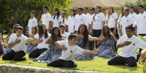 Students at the Ka Waihona o ka Na'auao Public Charter School perform the hula for U.S. Department of Education Secretary Arne Duncan during his visit in Nanakuli, Hawai'i, March 31, 2014. Photo by Eugene Tanner.