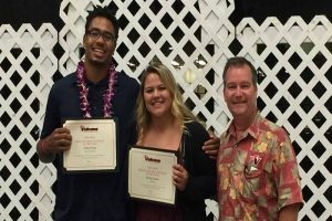 Salim Gloyd (left) and Bailey Gaspar earned the top Athlete of the Year awards at the Vulcan Awards Banquet. Director of Athletics Pat Guillen (right) presented the awards. UH-Hilo photo.