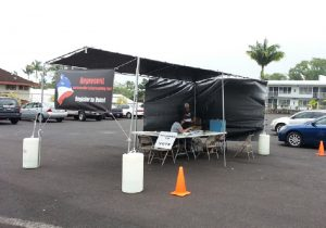 The Hilo drive-thru voter registration site in the northwest corner of the parking lot of the former Hilo Motors in 2014. File photo by Dave Smith.