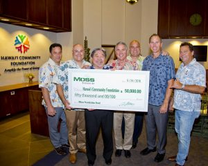 Check presentation participants included (left to right): Chad Johnston, business development Moss; Mike Mazza, EVP Moss; Kelvin H. Taketa, CEO of Hawaii Community Foundation; Doug Rogers, VP Moss; Micah A. Kāne, president and COO of Hawaii Community Foundation; and Dave Ciampini, VP BD Moss.