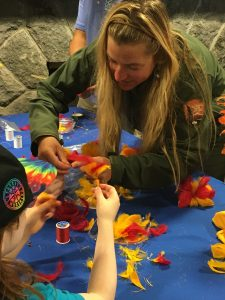 Park ranger demonstrates feather work