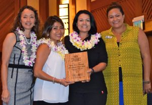 TMT was recognized last week by the Kona Kohala Chamber of Commerce for its community education work on Hawai'i Island. (Left to right) Dale Suezaki, KKCC Board Chair; TMT staffers Ashley Tanabe, Virginia Aragon-Barnes; and Kirstin Kahaloa, KKCC Executive Director.