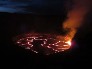 A wide view looking northeast, of the lake in Halemaʻumaʻu Crater as seen late Monday. Jaggar Museum and HVO are beyond the left edge of the photograph. Spattering was active in the southeast portion of the lake. The lava lake dropped more than 15 m (49 feet) between the time the photo was taken and mid-day Thursday, June 30, 2016. USGS photo.