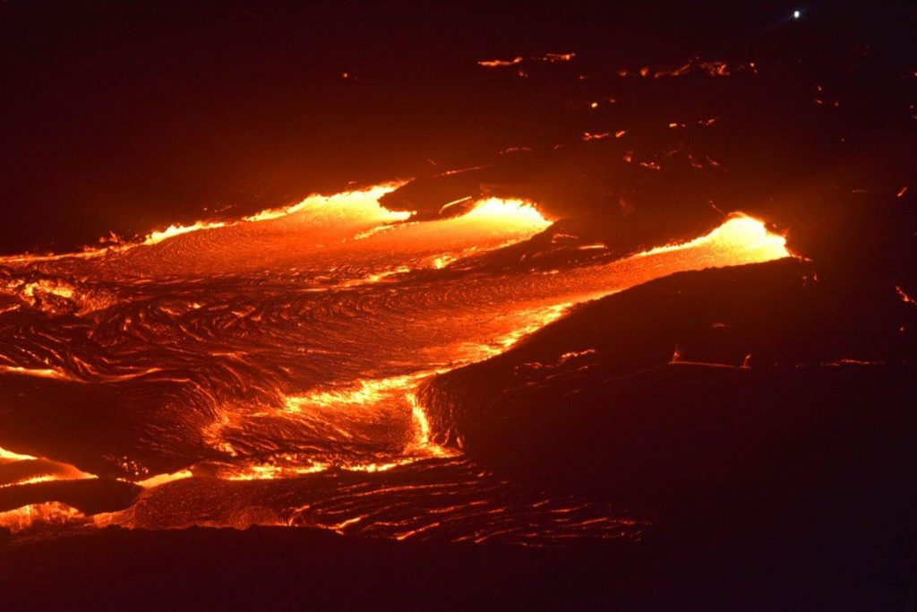Lava enters the ocean, July 26, 1:15 a.m. Photo courtesy of Kris Burmeister.