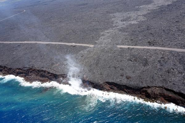 Just over two months since the start of the 61g flow, it reached the ocean on July 26 at 1:15 am HST. The narrow ocean entry was creating a small plume of gas and steam during today's overflight as the lava came into contact with the ocean. USGS photo.