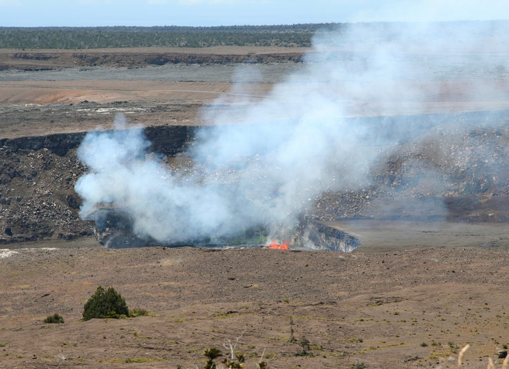 Visitors who happened to be at Jaggar Museum in Hawaiʻi Volcanoes National Park midday on July 20, 2016, got spectacular views of spattering lava within Kīlauea Volcano's summit vent, captured here with a zoomed-in camera. Views like this occasionally occur when the lava lake level is high and the spattering area is not obscured by the vent walls. On this day, the lava lake surface was 25 m (82 ft) below the vent rim. USGS photo.