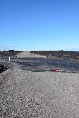 Flow 61G reached the emergency access road inside Hawai'i Volcanoes National Park on July 25 at 3:20 p.m. and crossed the road in about 30 minutes. At 4 p.m., the flow front was approximately 110 meters (.07 miles) from the ocean. USGS/HVO photo.