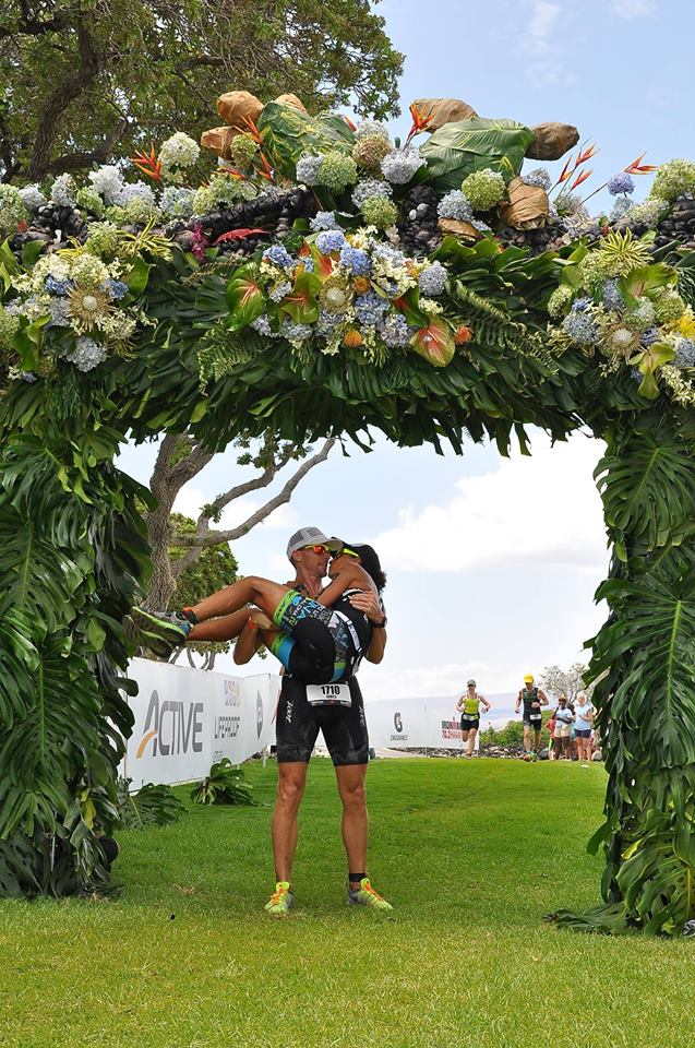 James Resor carrying his bride, Sarah, across the Honu finish line this past year. Courtesy photo.