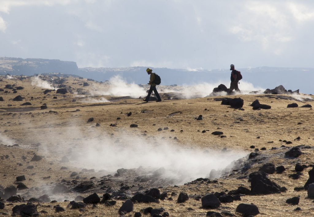 After completing their work on the rim of Halemaʻumaʻu Crater, Hawaiian Volcano Observatory scientists try to stay on pathways to avoid making footsteps in the Pele's hair that blankets the landscape, just as one shies from marring pristine snow. This area has been closed since 2008 due to elevated sulfur dioxide emissions and other ongoing volcanic hazards associated with Kīlauea's summit lava lake. USGS photo.