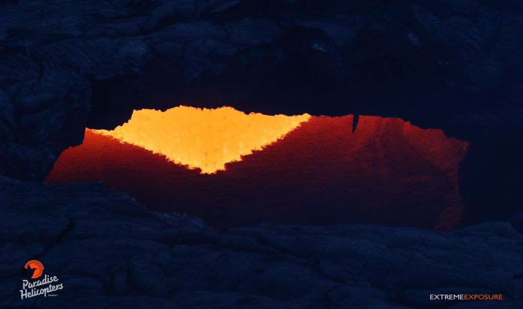 A large skylight about a mile and a half downslope of Pu'u 'O'o allowed a peek at the river of lava feeding flow 61G. Tropical Visions Video photo.