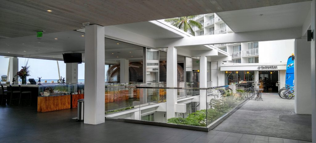 The hotel's $30 million renovation includes a contemporary lobby bar, glass cases, with rotating exhibits which feature and highlight Hilo's rich history and culture. KapohoKine Adventures also now located in the lobby at The Grand Naniloa Hotel Hilo – a DoubleTree by Hilton on Banyan Drive. Photo: Crystal Richard.